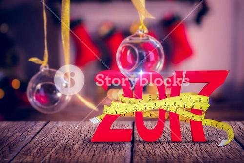 Composite image of digitally generated image of new year with tape measure