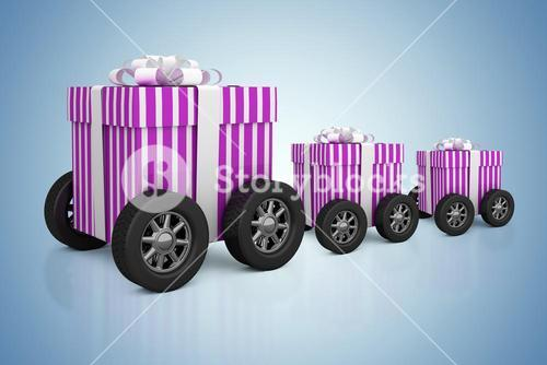 Composite image of gift on wheels