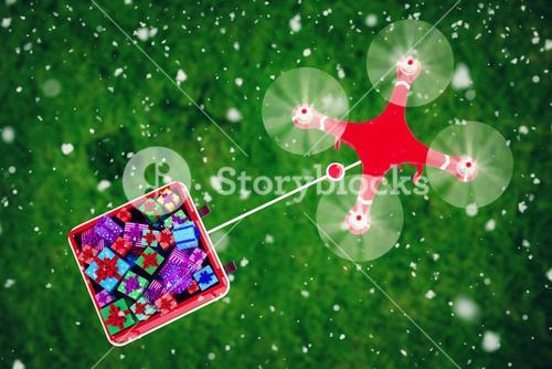 Composite image of overhead view of drone pulling chirstmas sledge