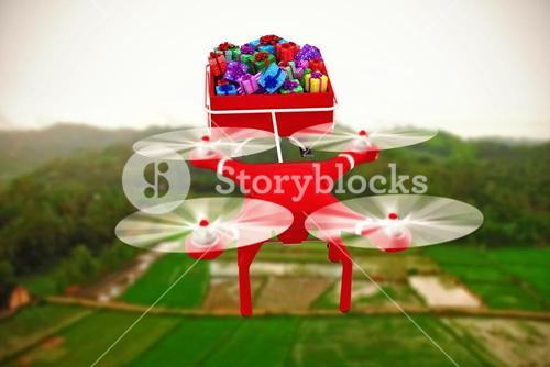 Composite image of high angle view of drone pulling chirstmas sledge