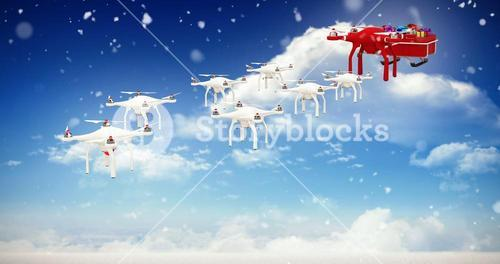 Composite image of mini drones pulling chirstmas sledge with gift
