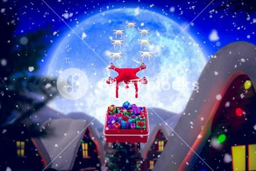 Composite image of mini drone pulling chirstmas sledge