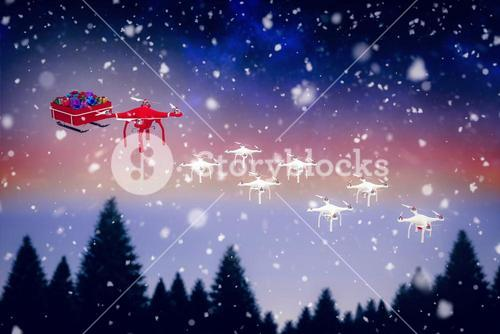 Composite image of high angle view of mini drone pulling chirstmas sledge