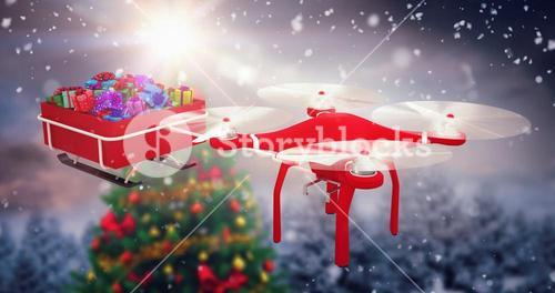 Composite image of high angle view of flying drone pulling chirstmas sledge