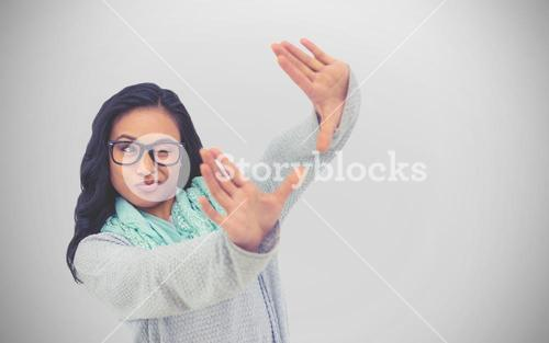 Composite image of asian woman making square with hands