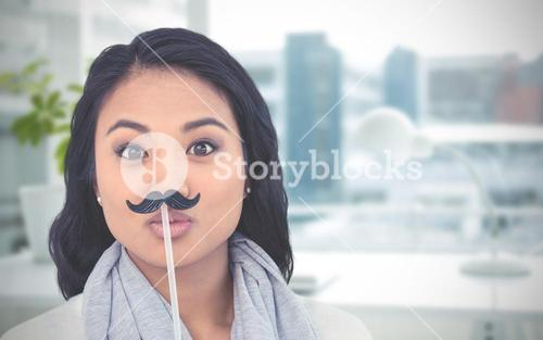Composite image of pretty asian woman with fake mustache posing for camera