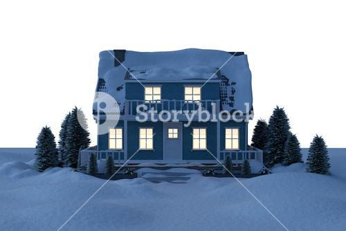 Illuminated house covered in snow