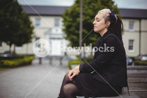 Businesswoman with eyes closed relaxing