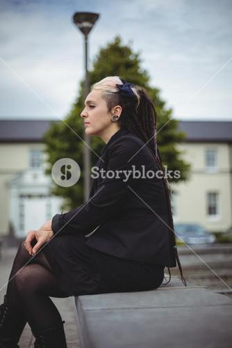 Thoughtful businesswoman relaxing
