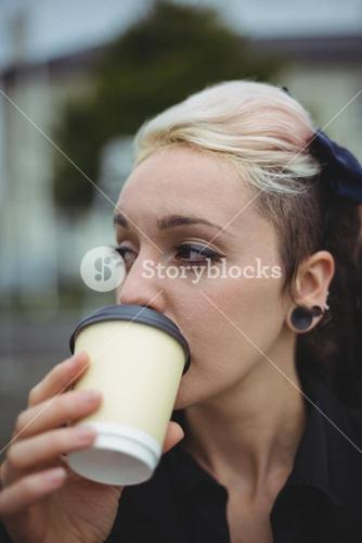 Close-up of businesswoman having coffee
