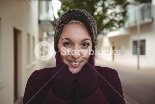 Beautiful woman posing with warm clothing