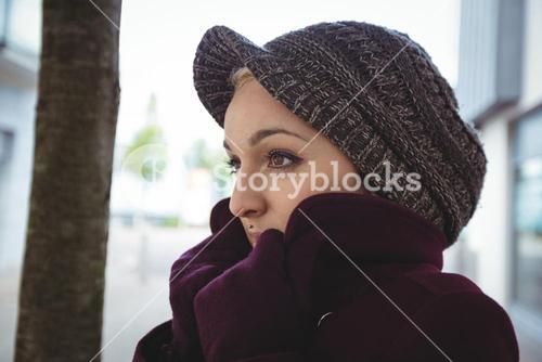 Woman shivering with cold
