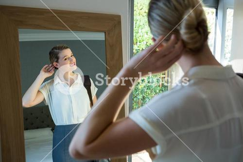 Woman getting ready for office in bedroom