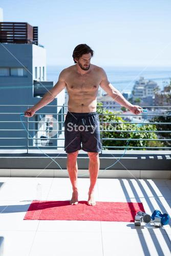 Man exercising with skipping ropes