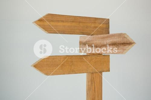 Wooden arrow direction sign post