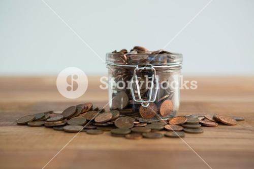 Close-up of coins in jar