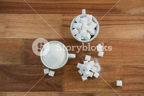 Cup of sugar powder and sugar cube