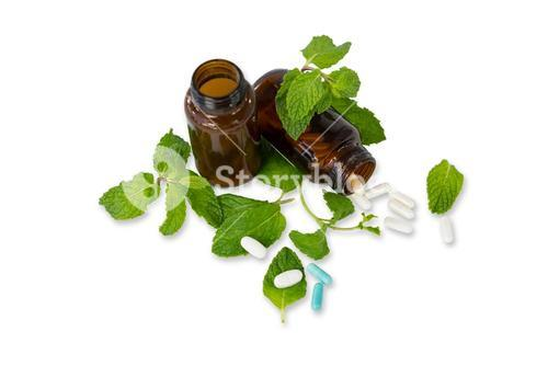 Medicine bottle with mint leaves