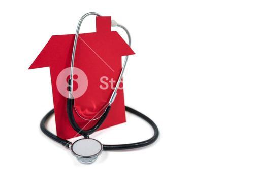 Toy house with stethoscope