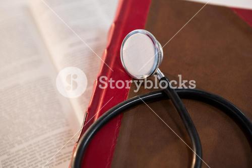 Stethoscope on open book