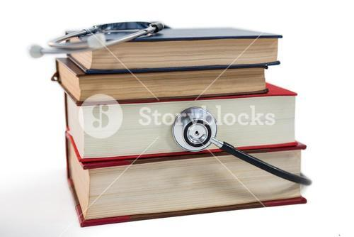 Stethoscope on stack of book
