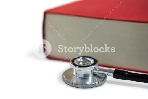 Stethoscope with book on white background