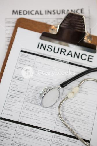 Clipboard with medical insurance paper and stethoscope