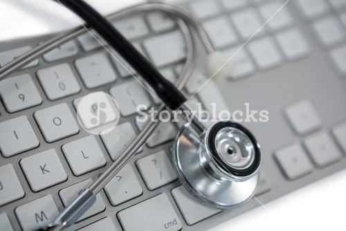 Close-up of stethoscope on laptop
