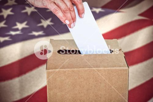 Composite image of businesswoman putting ballot in vote box
