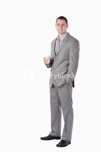 Portrait of a businessman holding a cup of coffee