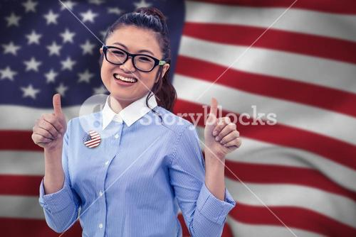 Composite image of smiling asian businesswoman showing thumbs up