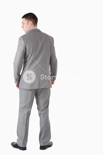 Portrait of a businessman turning his back