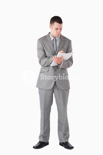Portrait of a businessman taking notes