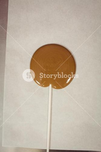 Close-up of lollipop drying on wax paper