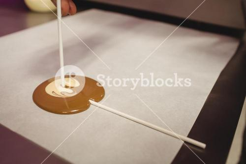 Preparation of lollipop on wax paper