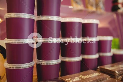 Stacked chocolate containers in display