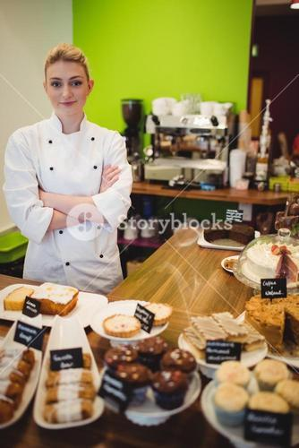 Portrait of worker standing at chocolate counter