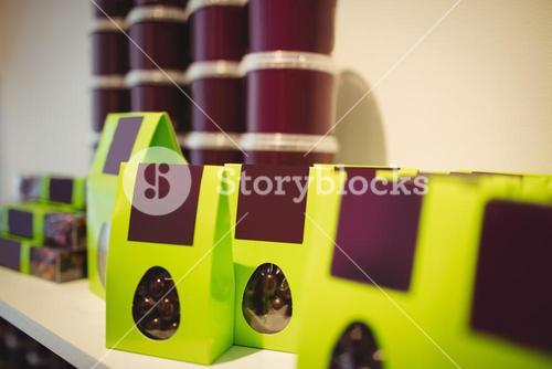 Packed chocolates in green box in display