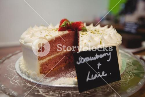 Close-up of strawberry cake on cakestand