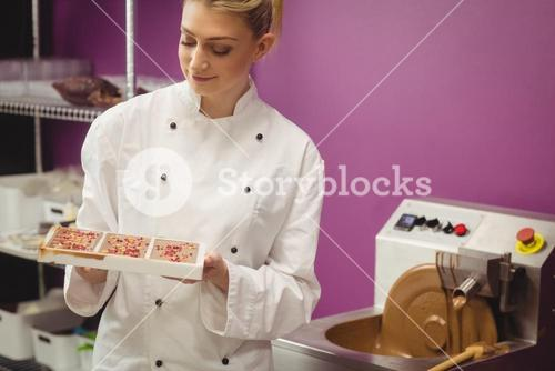 Worker holding chocolate mould