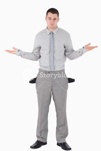Portrait of a young businessman with empty pockets