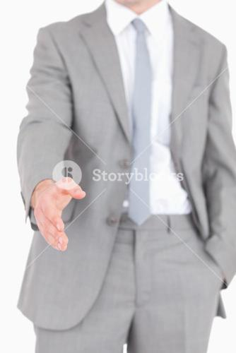 Portrait of a businessman ready for a handshake