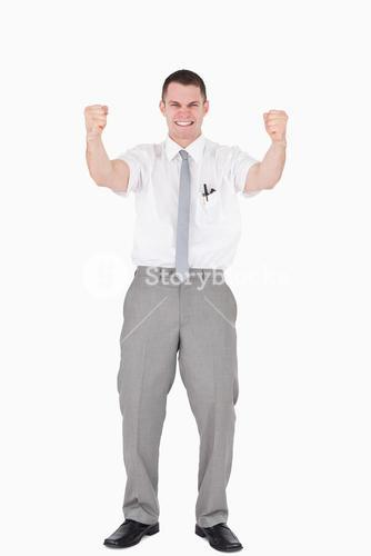 Portrait of a successful salesperson with fists up