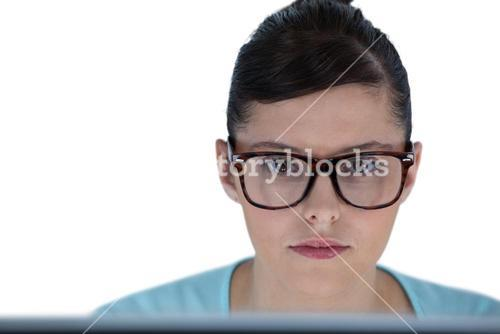 Portrait of businesswoman working over computer