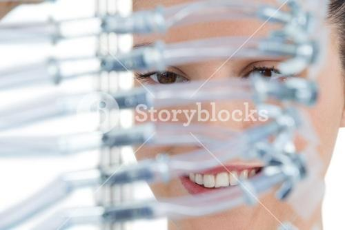 Female computer engineer holding computer cable