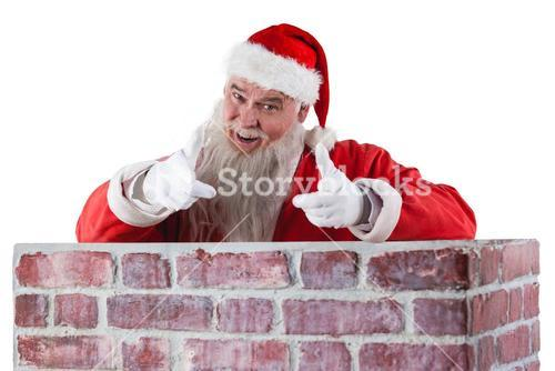 Portrait of happy santa claus making hand gesture over the wall