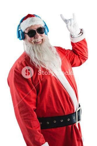 Santa claus showing hand yo sign while listening to music on headphones
