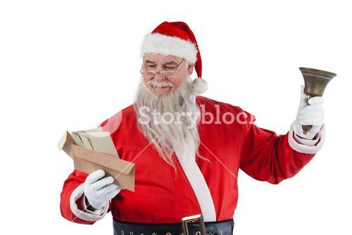 Santa claus holding envelope and handle bell