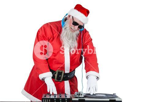 Santa claus playing a dj