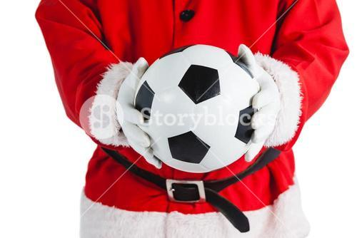 Santa claus holding a football